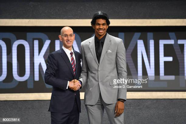 Jarrett Allen smiles with Adam Silver after being the 22nd overall pick by the Brooklyn Nets at the 2017 NBA Draft on June 22 2017 at Barclays Center...