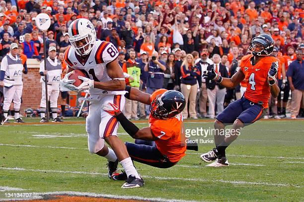 Jarrett Boykin of the Virginia Tech Hokies catches the ball for a touchdown ahead of Corey Mosley of the Virginia Cavaliers at Scott Stadium on...