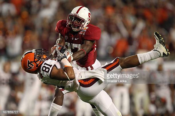 Jarrett Boykin of the Virginia Tech Hokies makes a recption in the seocnd quarter against Johnson Bademosi of the Stanford Cardinal during the 2011...