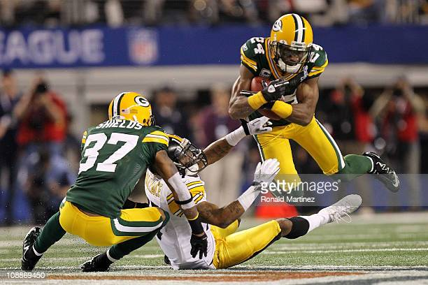 Jarrett Bush of the Green Bay Packers intercepts a pass intended for Mike Wallace of the Pittsburgh Steelers during the second quarter of Super Bowl...