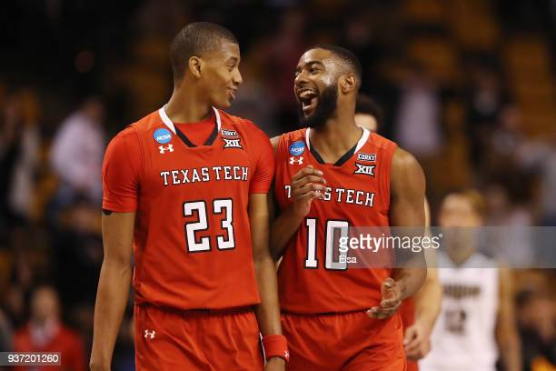 Jarrett Culver and Niem Stevenson of the Texas Tech Red Raiders celebrate defeating the Purdue Boilermakers 78-65 in the 2018 NCAA Men's Basketball...