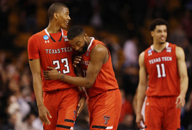 Jarrett Culver and Niem Stevenson of the Texas Tech Red Raiders celebrate defeating the Purdue Boilermakers 7865 in the 2018 NCAA Men's Basketball...