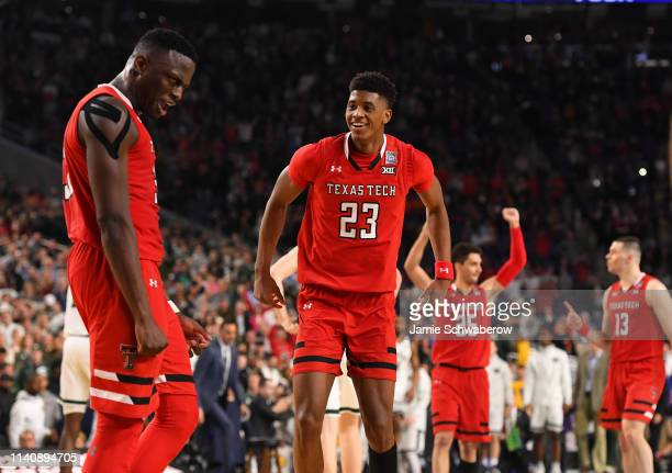 Jarrett Culver of the Texas Tech Red Raiders and Deshawn Corprew of the Texas Tech Red Raiders react to winning the semifinal game in the NCAA Photos...