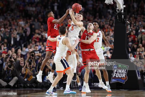 Jarrett Culver of the Texas Tech Red Raiders and Kyle Guy of the Virginia Cavaliers battle for the ball i2g during the 2019 NCAA men's Final Four...