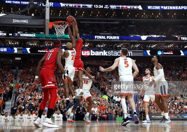 Jarrett Culver of the Texas Tech Red Raiders attempts a shot against Mamadi Diakite of the Virginia Cavaliers in the first half during the 2019 NCAA...