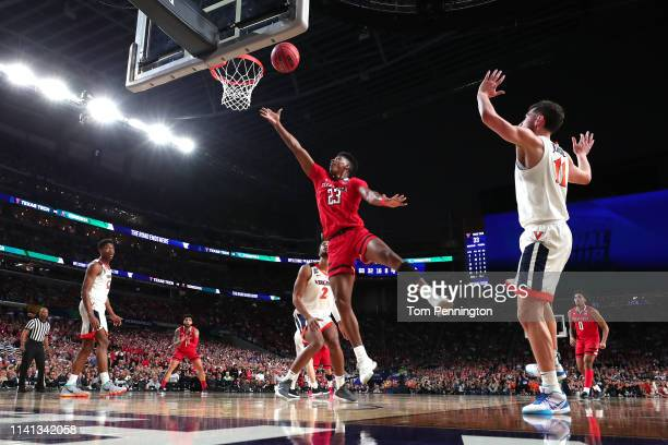 Jarrett Culver of the Texas Tech Red Raiders attempts a shot against the Virginia Cavaliers in the second half during the 2019 NCAA men's Final Four...