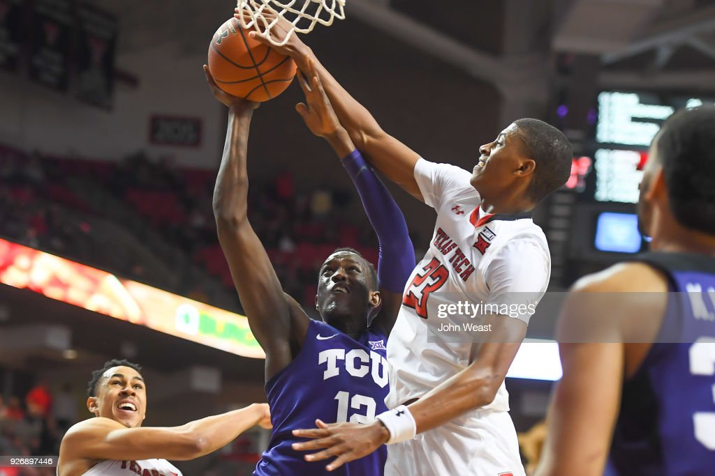 Jarrett Culver #23 of the Texas Tech Red Raiders blocks the shot attempt of Kouat Noi #12 of the TCU Horned Frogs during the second half of the game on March 3, 2018 at United Supermarket Arena in Lubbock, Texas. Texas Tech defeated TCU