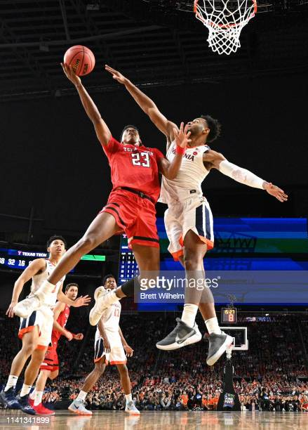 Jarrett Culver of the Texas Tech Red Raiders drives to the basket against Braxton Key of the Virginia Cavaliers during the second half of the 2019...