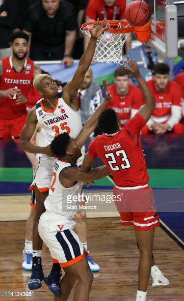Jarrett Culver of the Texas Tech Red Raiders drives to the basket against Mamadi Diakite of the Virginia Cavaliers during the second half of the 2019...