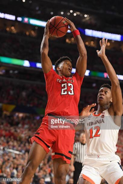 Jarrett Culver of the Texas Tech Red Raiders drives to the basket against De'Andre Hunter of the Virginia Cavaliers during the second half of the...