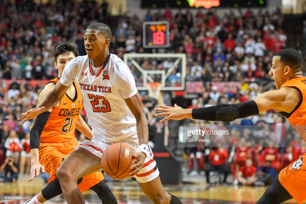 Jarrett Culver #23 of the Texas Tech Red Raiders drives to the basket against Lindy Waters III #21 of the Oklahoma State Cowboys during the second half of the game on January 23, 2018 at United Supermarket Arena in Lubbock, Texas. Texas Tech defeated Oklahoma State 75-70.