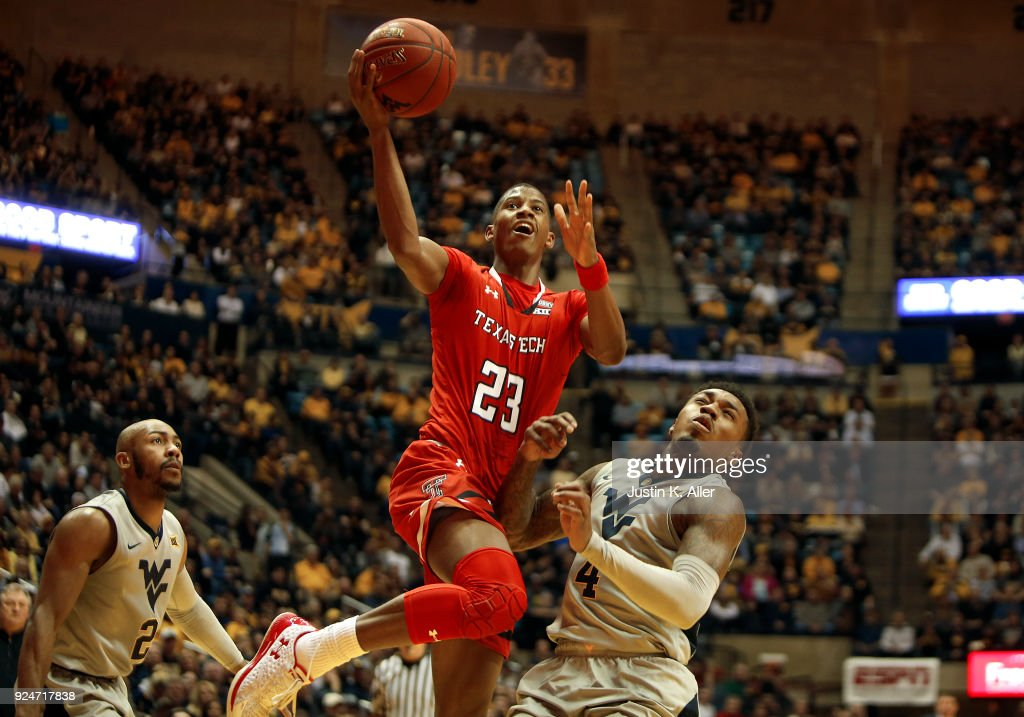 Jarrett Culver #23 of the Texas Tech Red Raiders drives to the basket against Daxter Miles Jr. #4 of the West Virginia Mountaineers at the WVU Coliseum on February 26, 2018 in Morgantown, West Virginia.