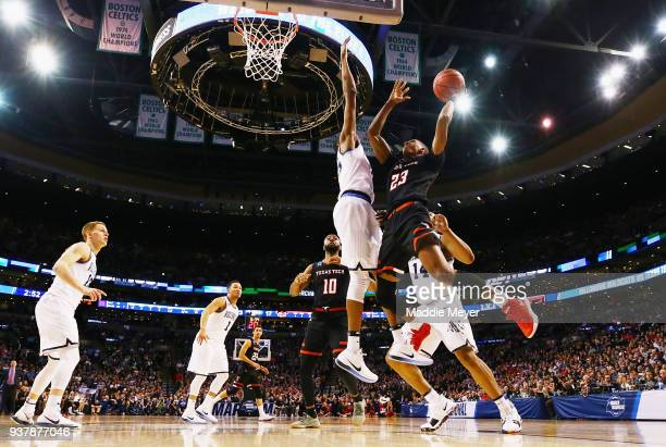 Jarrett Culver of the Texas Tech Red Raiders drives to the basket against Mikal Bridges of the Villanova Wildcats during the first half in the 2018...