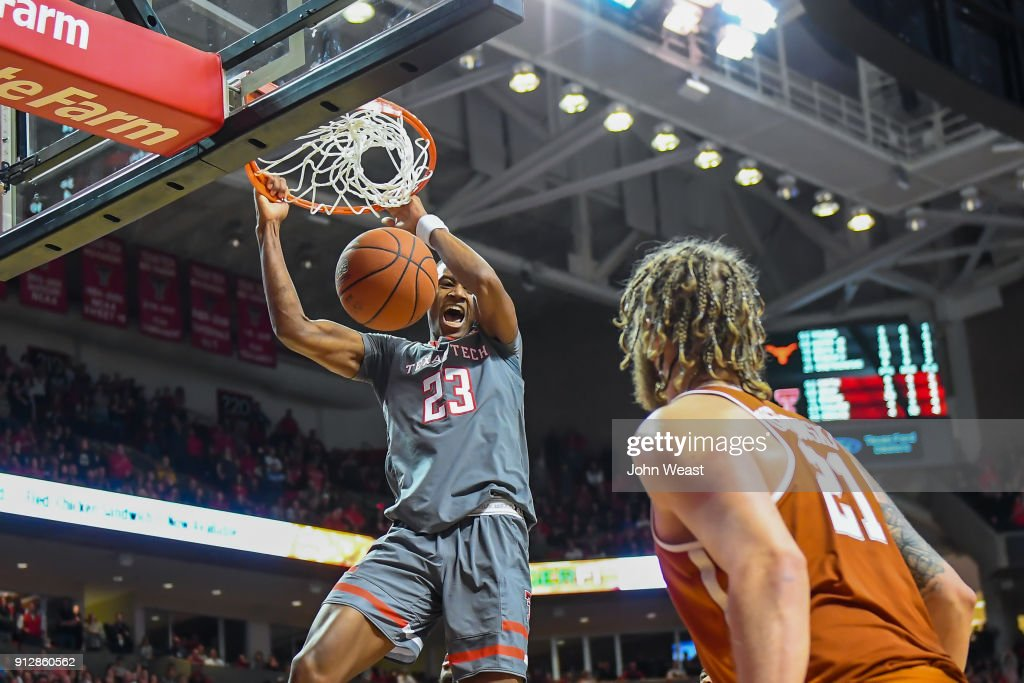 Jarrett Culver #23 of the Texas Tech Red Raiders dunks over Dylan Osetkowski #21 of the Texas Longhorns on January 31, 2018 at United Supermarket Arena in Lubbock, Texas. Texas Tech defeated Texas 73-71 in overtime.