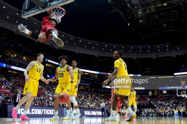 Jarrett Culver of the Texas Tech Red Raiders dunks the ball against the Michigan Wolverines during the 2019 NCAA Men's Basketball Tournament West...