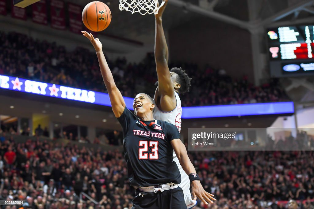Jarrett Culver #23 of the Texas Tech Red Raiders goes to the basket against Udoka Azubuike #35 of the Kansas Jayhawks during the second half of the game on February 24, 2018 at United Supermarket Arena in Lubbock, Texas. Kansas defeated Texas Tech 74-72.