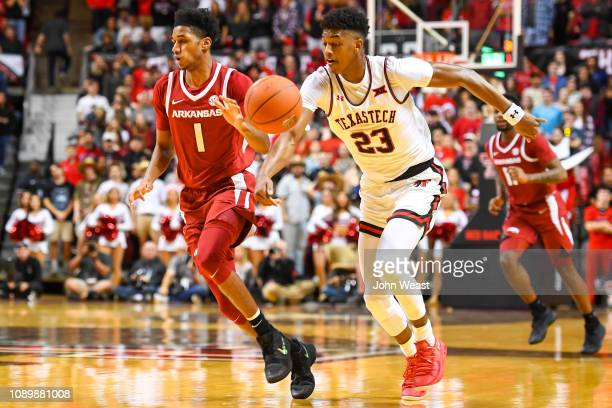 Jarrett Culver of the Texas Tech Red Raiders knocks the ball away from Isaiah Joe of the Arkansas Razorbacks during the first half of the game on...