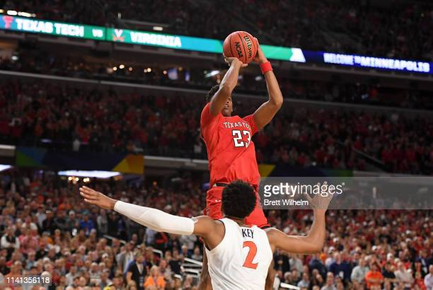 Jarrett Culver of the Texas Tech Red Raiders shoots over Braxton Key of the Virginia Cavaliers during overtime in the 2019 NCAA men's Final Four...