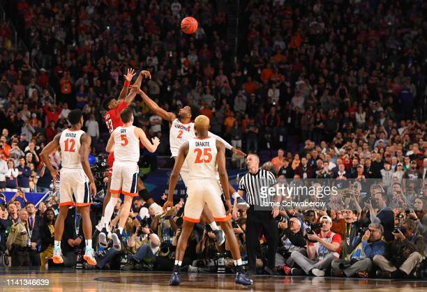 Jarrett Culver of the Texas Tech Red Raiders shoots the ball against Braxton Key of the Virginia Cavaliers during the second half of the 2019 NCAA...