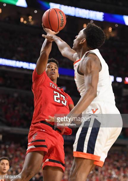 Jarrett Culver of the Texas Tech Red Raiders shoots the ball over De'Andre Hunter of the Virginia Cavaliers during the second half of the 2019 NCAA...