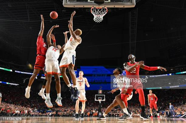 Jarrett Culver of the Texas Tech Red Raiders shoots the ball over De'Andre Hunter of the Virginia Cavaliers during overtime of the 2019 NCAA men's...