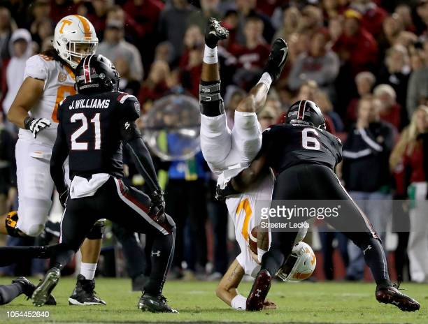 Jarrett Guarantano of the Tennessee Volunteers is hit by TJ Brunson of the South Carolina Gamecocks during their game at WilliamsBrice Stadium on...
