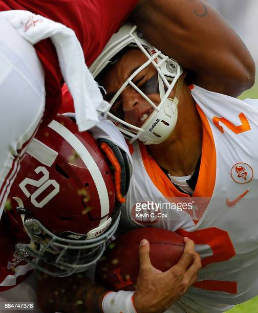 Jarrett Guarantano of the Tennessee Volunteers is tackled by Shaun Dion Hamilton and Anfernee Jennings of the Alabama Crimson Tide at BryantDenny...