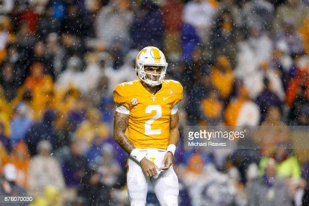 Jarrett Guarantano of the Tennessee Volunteers looks to the sideline for a play call against the LSU Tigers during the first half at Neyland Stadium...