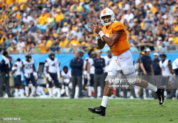 Jarrett Guarantano of the Tennessee Volunteers reacts after a play against the West Virginia Mountaineers during their game at Bank of America...