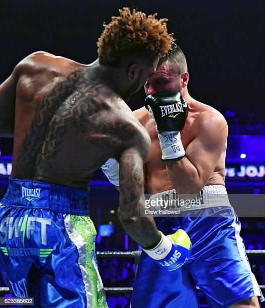 Jarrett Hurd punches JoJo Dan in the groin at Liacouras Center on November 12 2016 in Philadelphia Pennsylvania