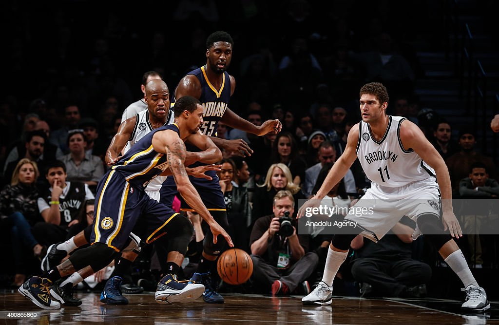 Jarrett Jack #0 and Brook Lopez #11 of Brooklyn Nets in action against George Hill #3 and Roy Hibbert #55 of Indiana Pacers during an NBA game on December 27, 2014 at Barclays Center in Brooklyn, New York.