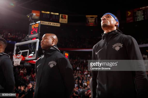 Jarrett Jack and Michael Beasley of the New York Knicks stand for the National Anthem before the game against the Portland Trail Blazers on March 6...