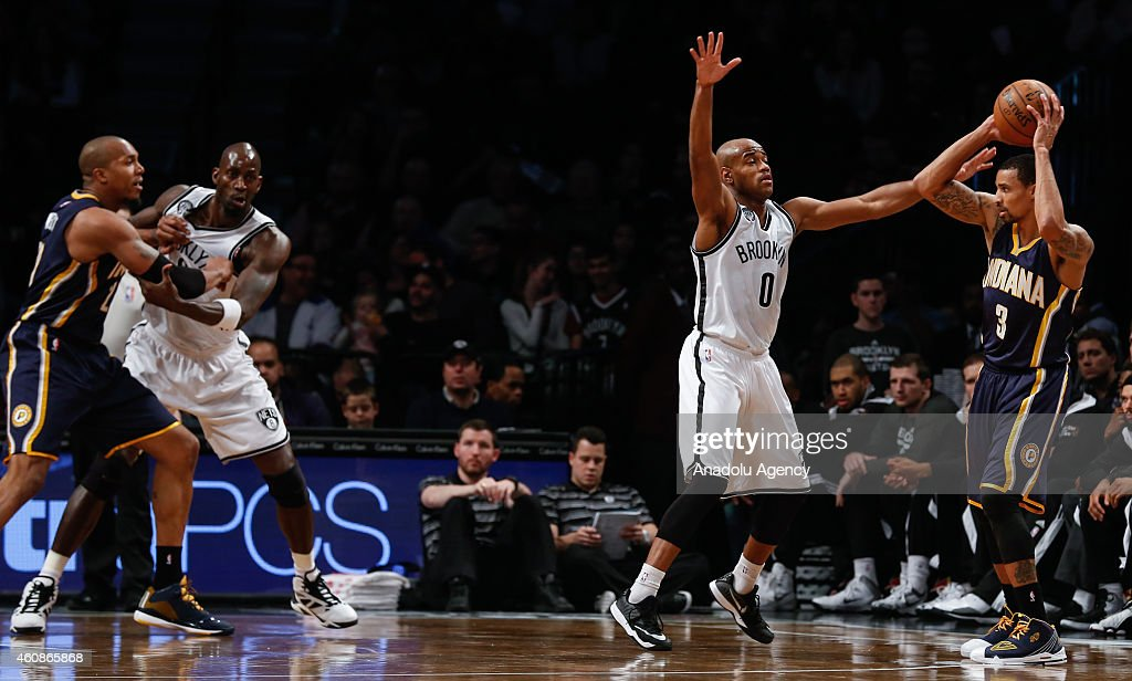 Jarrett Jack #0 of Brooklyn Nets in action against George Hill #3 of Indiana Pacers during an NBA game on December 27, 2014 at Barclays Center in Brooklyn, New York.
