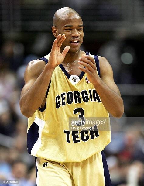 Jarrett Jack of the Georgia Tech Yellow Jackets celebrates against the North Carolina Tar Heels during their semi-final ACC Tournament game on March...