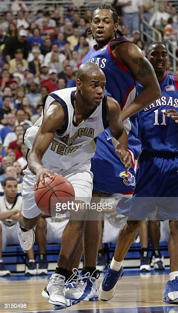 Jarrett Jack of the Georgia Tech Yellow Jackets drives past Jeff Graves of the Kansas Jayhawks during the fourth round game of the NCAA Division I...