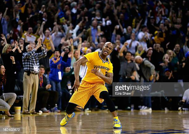 Jarrett Jack of the Golden State Warriors celebrates after he made a threepoint basket in the fourth period of their game against the San Antonio...