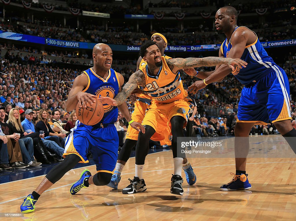 Jarrett Jack #2 of the Golden State Warriors controls the ball and is fouled by Wilson Chandler #21 of the Denver Nuggets during Game Two of the Western Conference Quarterfinals of the 2013 NBA Playoffs at the Pepsi Center on April 23, 2013 in Denver, Colorado.
