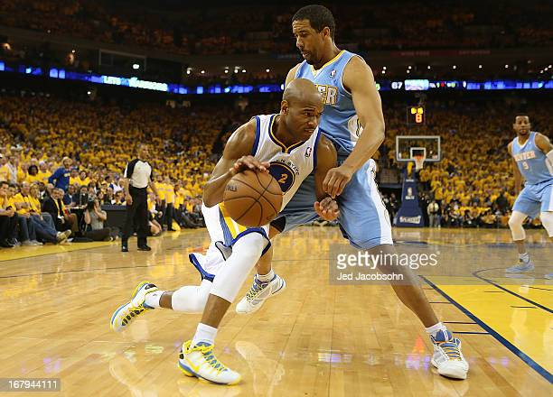 Jarrett Jack of the Golden State Warriors drives against Andre Miller of the Denver Nuggets during Game Six of the Western Conference Quarterfinals...