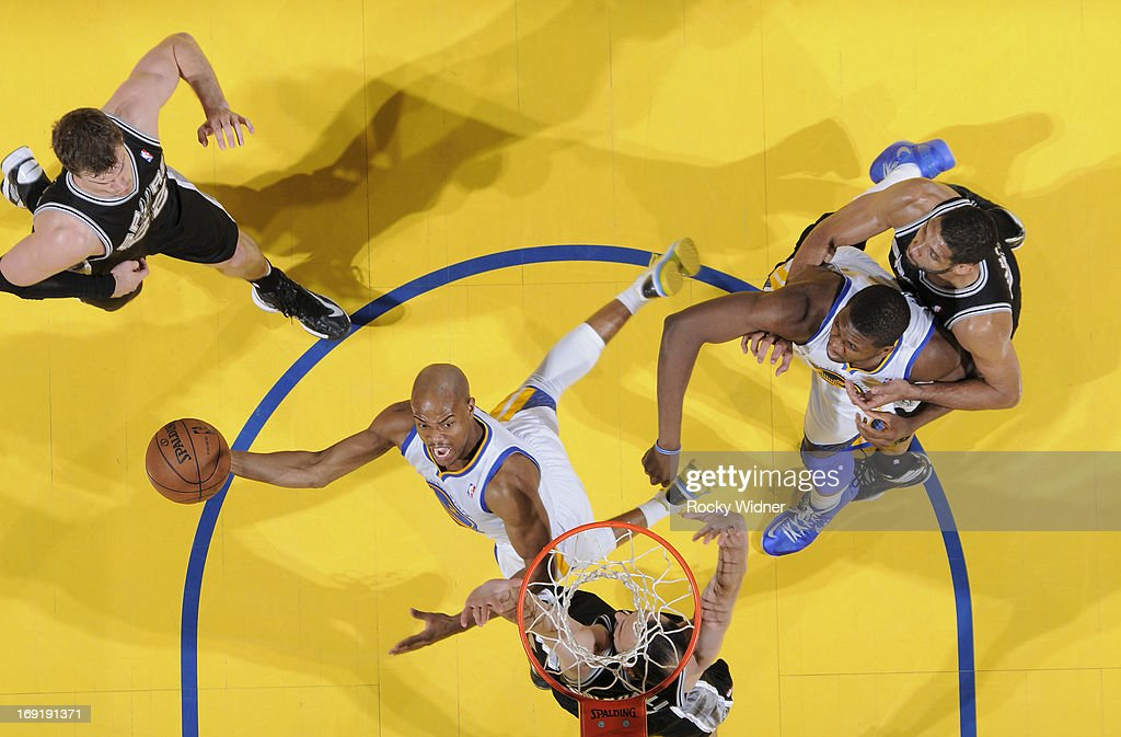 Jarrett Jack #2 of the Golden State Warriors shoots a layup against Manu Ginobili #20 of the San Antonio Spurs in Game Six of the Western Conference Semifinals during the 2013 NBA Playoffs on May 16, 2013 at Oracle Arena in Oakland, California.
