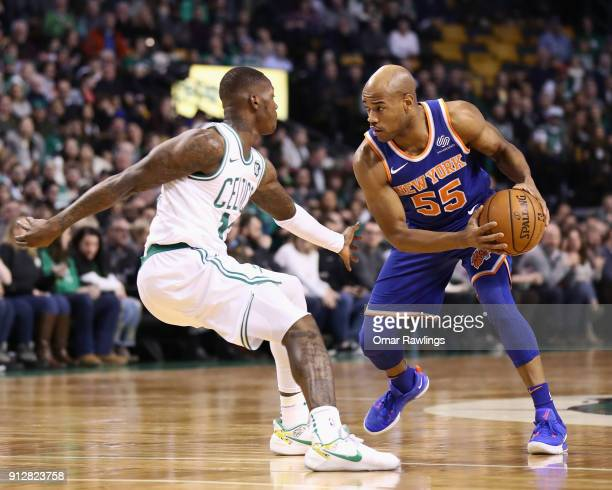 Jarrett Jack of the New York Knicks drives to the basket on Terry Rozier of the Boston Celtics during the first quarter of the game at TD Garden on...