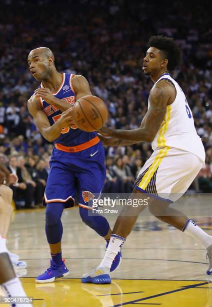 Jarrett Jack of the New York Knicks passes around Nick Young of the Golden State Warriors at ORACLE Arena on January 23 2018 in Oakland California...