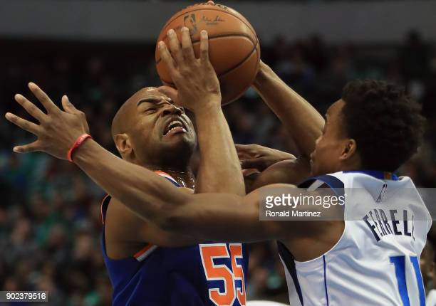 Jarrett Jack of the New York Knicks takes a shot against Yogi Ferrell of the Dallas Mavericks at American Airlines Center on January 7 2018 in Dallas...