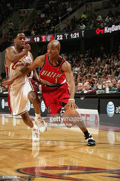 Jarrett Jack of the Portland Trail Blazers drives past Damon Jones of the Cleveland Cavaliers during a game at Quicken Loans Arena on March 17 2006...