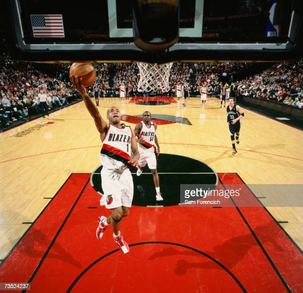 Jarrett Jack of the Portland Trail Blazers drives to the basket for a layup during a game against the Memphis Grizzlies at The Rose Garden on...