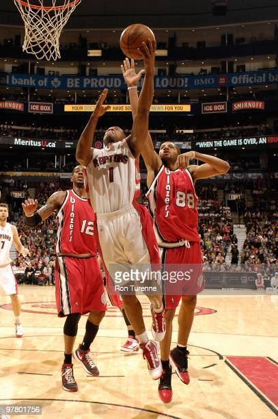 Jarrett Jack of the Toronto Raptors goes to the basket against Nicolas Batum of the Portland Trail Blazers during the game on February 24 2010 at Air...