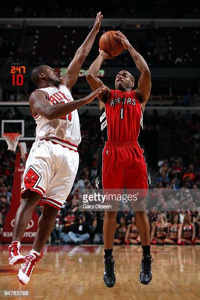 Jarrett Jack of the Toronto Raptors shoots against Lindsey Hunter of the Chicago Bulls during the game on December 5 2009 at the United Center in...