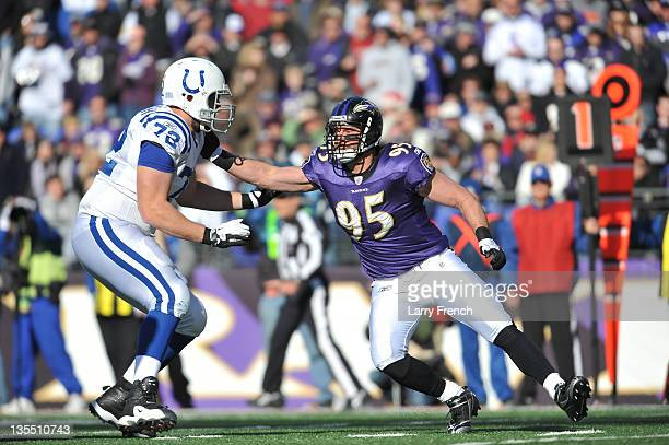 Jarrett Johnson of the Baltimore Ravens defends against Jeff Linkenbach of the Indianapolis Colts at MT Bank Stadium on December 11 2011 in Baltimore...