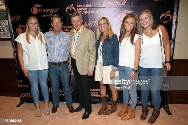Jarrett Kemp Georgia Governor Brian Kemp musician Bill Anderson Marty Kemp Amy Porter Kemp and Lucy Kemp pose backstage during the 6th Annual Georgia...