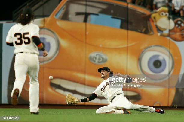 Jarrett Parker of the San Francisco Giants catches a fly ball hit by Yadier Molina of the St Louis Cardinals in the ninth inning at ATT Park on...