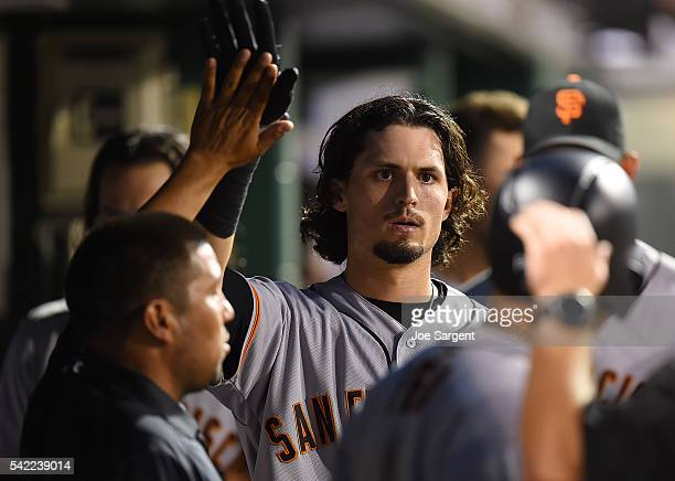 Jarrett Parker of the San Francisco Giants celebrates with teammates after scoring during the sixth inning against the Pittsburgh Pirates on June 22...